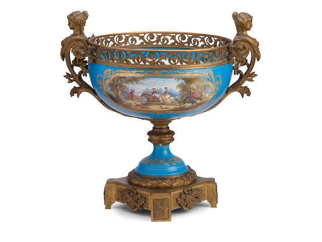 A large Sèvres style twin handled centrepiece with gilt metal mounts Circa 1900