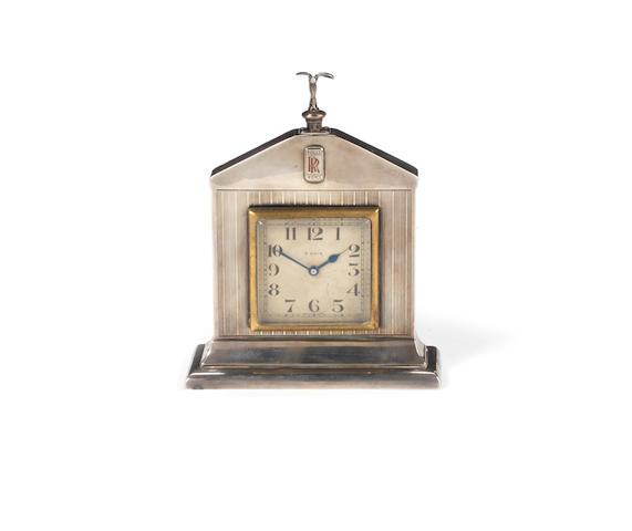 A SILVER CLOCK DESK PIECE BY SAUNDERS & SHEPHERD, 1927 ROLLS-ROYCE CHRISTMAS GIFT,