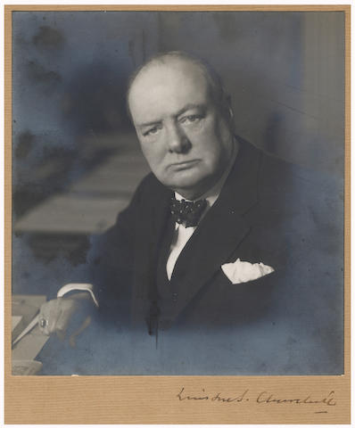 """CHURCHILL (WINSTON) Photograph signed (""""Winston S. Churchill"""") on the mount, showing Churchill at the Cabinet Table, half length, facing the camera, by Walter Stoneman, [1 April 1941]"""
