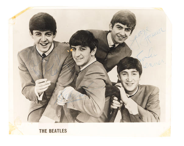 The Beatles: a black and white publicity photograph by Dezo Hoffman signed by each member of the band, 24th March, 1964,