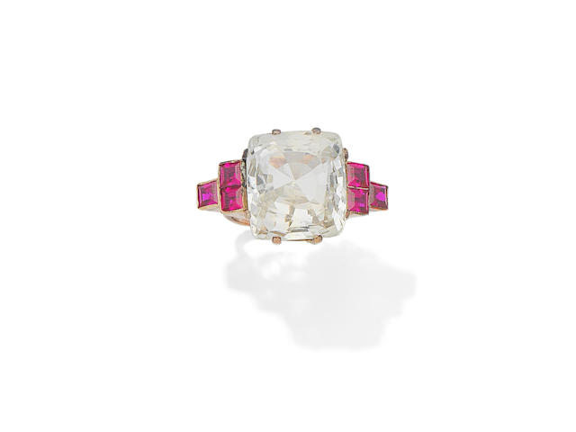 A pale green sapphire and synthetic ruby dress ring, circa 1940