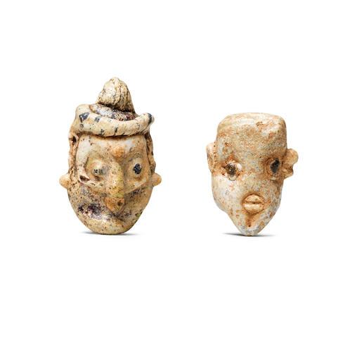 Two Phoenician glass head pendants 2