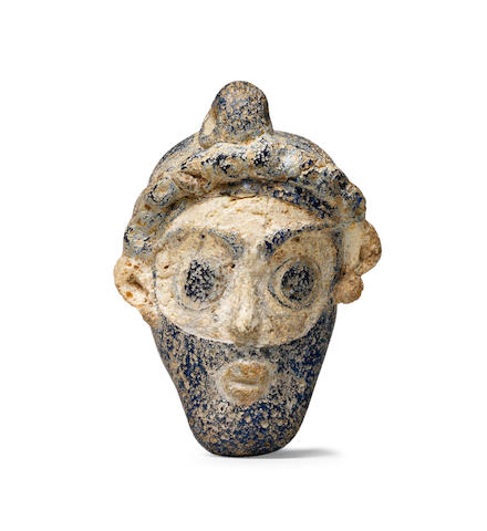 A Phoenician glass male head pendant