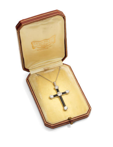 An onyx and diamond cross pendant necklace, by Lacloche Frères, circa 1925