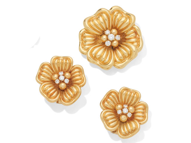 A diamond flower brooch and earclip suite, circa 1960