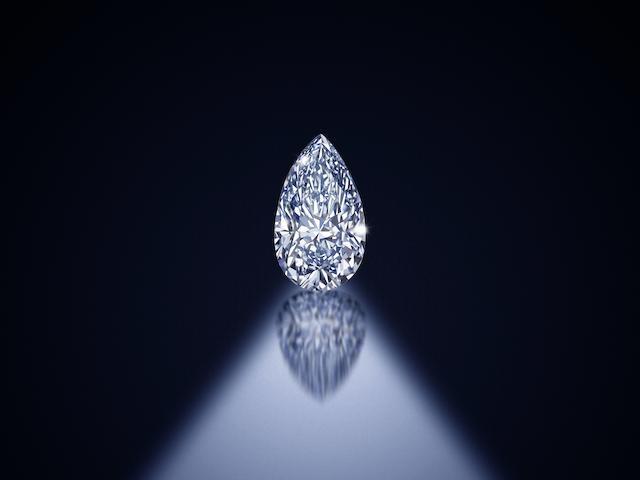 An impressive fancy-coloured diamond two-stone pendant