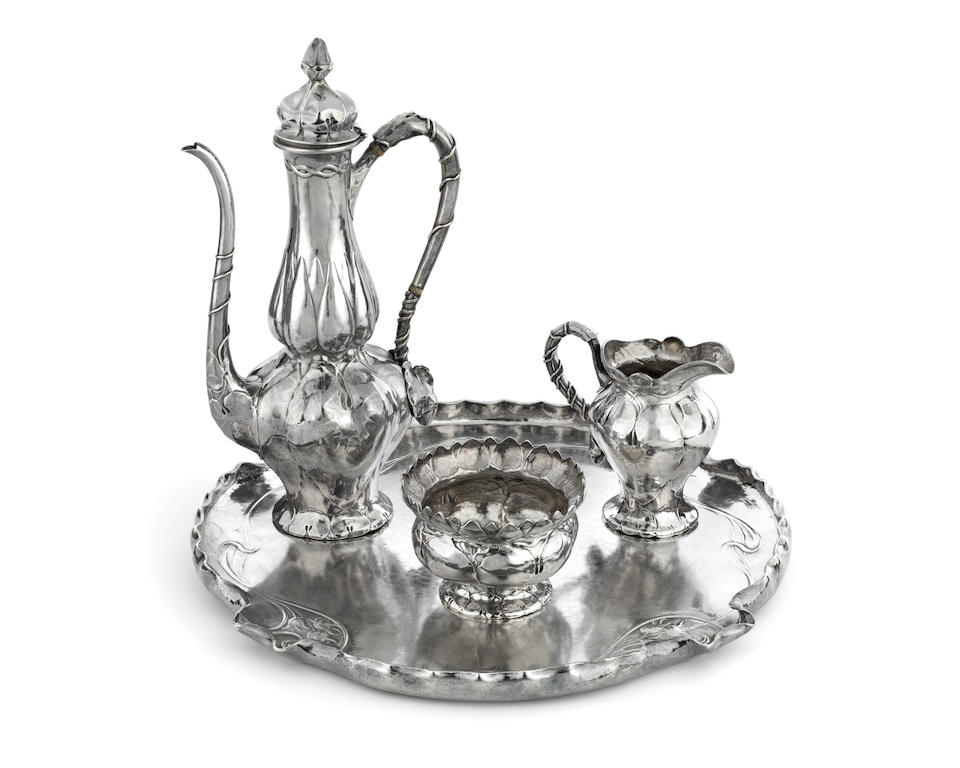 A 19th century American 'Martelé' silver three-piece coffee service together with a tray by Gorham Mfg Co, Rhode Island, with date letter marks for 1897/98, the tea service with pattern number '8580', the tray '8908'  (4)