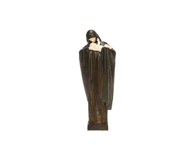 an art deco patinated bronze and carved ivory study of the madonna and child by Heuvelmans SIGNED IN CAST; CIRCA 1925