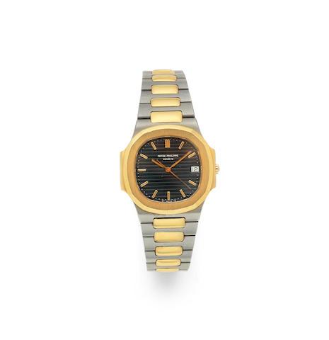 Patek Philippe. A stainless steel and gold quartz calendar bracelet watch  Nautilus, Ref: 3900/1, Circa 1990