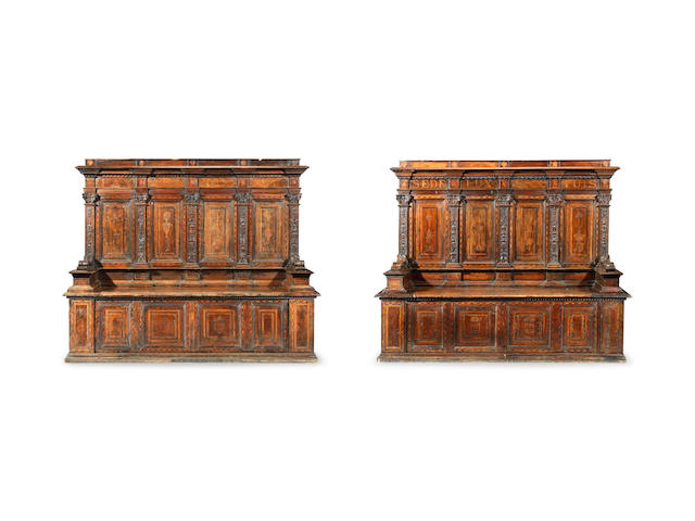 A pair of rare early to mid-16th century walnut, fruitwood and marquetry cassapancas, Italian, probably Florentine, circa 1500 - 1550   (2)