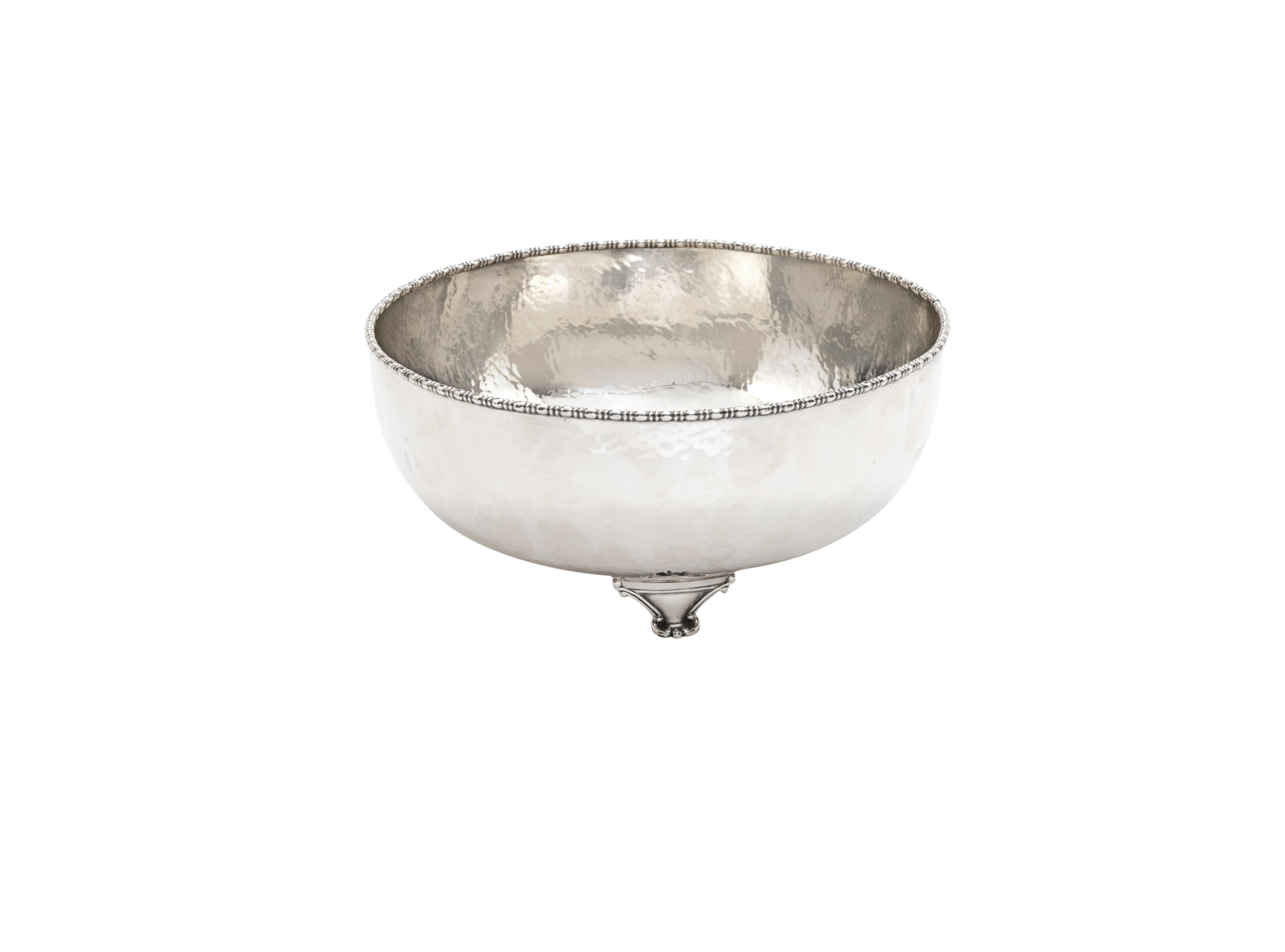 A footed silver punch bowl attributed to jean després