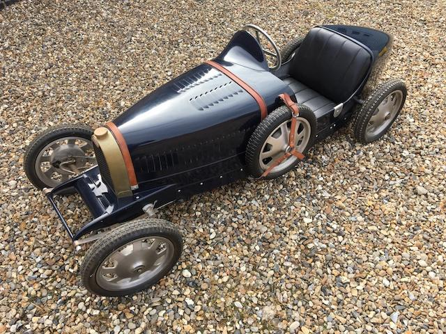 An electrically-powered 'Type 52 Baby Bugatti' replica child's car by Pur Sang of Argentina, circa 2005,