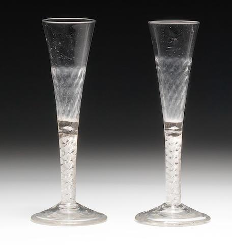 A near pair of airtwist ratafia glasses or flutes, circa 1755