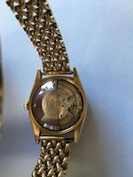 Rolex. An 18K gold automatic calendar bracelet watch Ref: 6105, Circa 1952