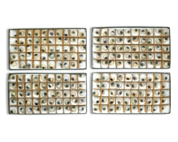 A collection of approximately 200 artificial glass eyes, English, Late 19th Century (4 boxes)
