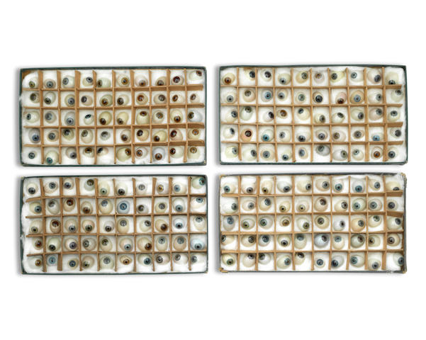 A collection of approximately 200 artificial glass eyes,  English, Late 19th Century, (4 boxes)