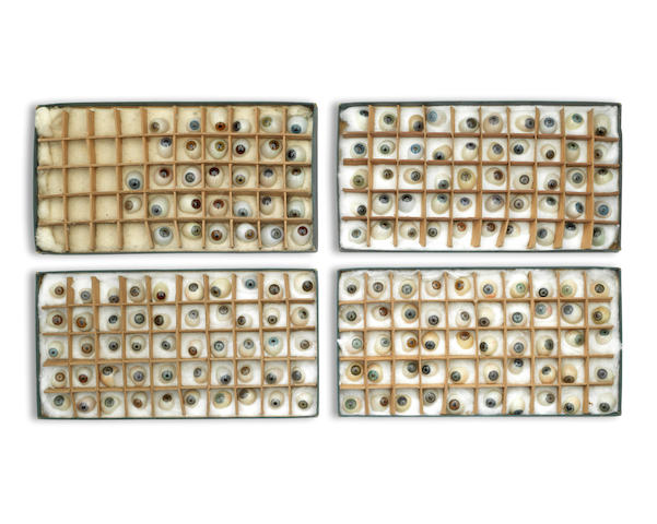 A collection of approximately 181 artificial glass eyes, English, Late 19th Century (4 boxes)