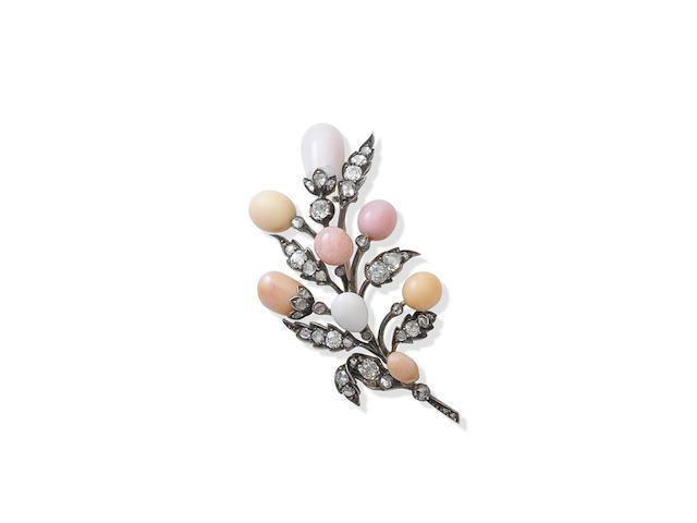A conch pearl and diamond spray brooch,