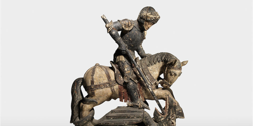 A large carved wood and polychrome decorated equestrian figural group of St. George and the Dragon probably French Alsace, late 15th / early 16th century