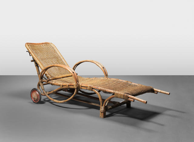 Erich Dieckmann:  A rare poolside chaise, designed and executed c.1930 Bentwood, woven cane, red enamelled steel and rubber wheels 66cm x 197cm x 94cm