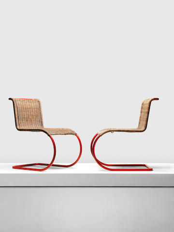 Ludwig Mies van der Rohe,  A pair of MR10 chairs, designed 1927, executed c.1931 by Gebrüder Thonet Red-painted tubular steel, woven cane 47cm x 68cm x 79.5cm