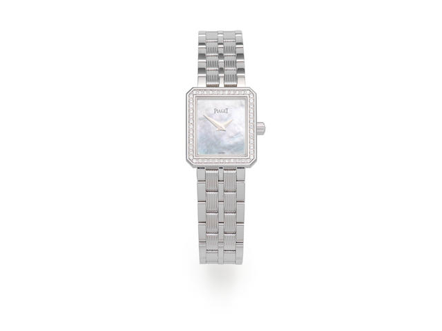 Piaget. A lady's 18K white gold and diamond set quartz bracelet watch  Protocole, Ref: 5355 M601D, Circa 2004