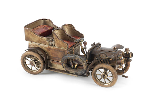 A fine Chevob & Co, late Baker-Troll & Co musical smoker's companion in form of four-seat open tourer circa 1904, Swiss,