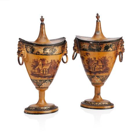 A pair of Regency toleware chestnut urns