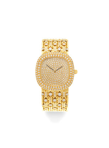 A custom made heavy 18K gold and diamond set automatic bracelet watch Circa 1980