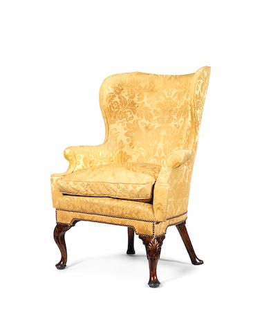 A George II carved walnut tub back armchair