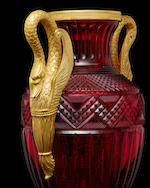 A fine pair of large ormolu-mounted cranberry-colored cut glass vases in the Russian Empire styleattributed to Imperial Glass Factory, St. Peterburg, probably after a design by Ivan Ivanov, c. 1820