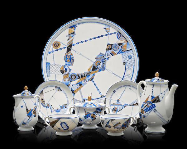 An early Soviet porcelain tea service decorated with industrial motifsLomonosov Porcelain Factory, Leningrad, 1931, forms designed by Sergei Chekhonin (1878-1936), ornamentation design by L.V. Protopopova (1906-1981), factory painter's mark in Cyrillic 'B.K.S.'