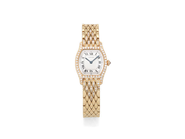 Cartier. A lady's 18K gold and diamond set manual wind tonneau form bracelet watch  Tortue, Circa 2000