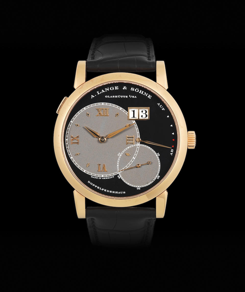 A. Lange & Söhne. An 18K rose gold manual wind calendar wristwatch with power reserve  Lange 1, Circa 2003