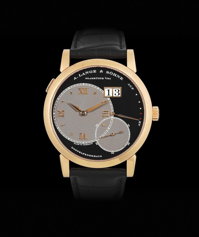 A. Lange & Söhne. An 18K rose gold manual wind calendar wristwatch with power reserve  Lange 1, Circa 2003