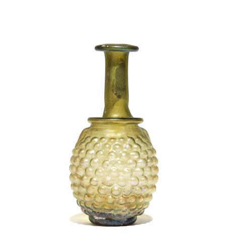 A Roman pale green glass grape flask