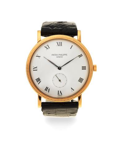 Patek Philippe. An 18K gold manual wind wristwatch  Calatrava, Ref: 3919, Circa 1990