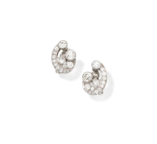 A pair of mid-century diamond earrings