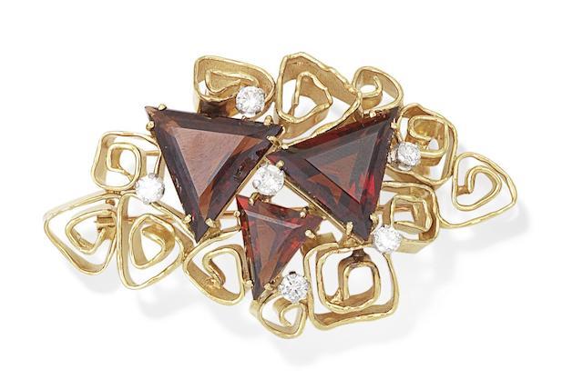 A garnet and diamond brooch, by George Weil,