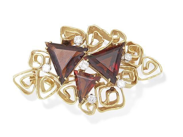 A garnet and diamond brooch, by George Weil,