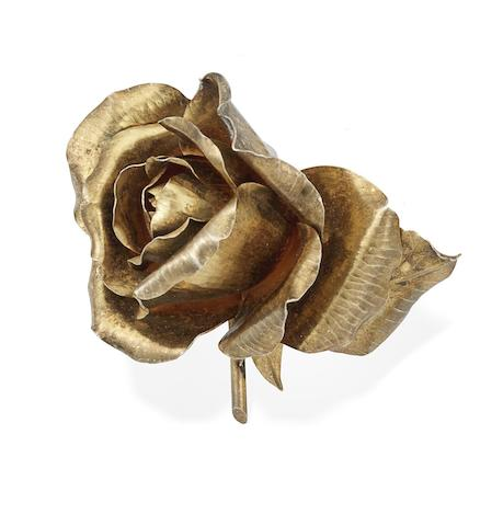 A gilt-metal rose brooch, by G. Lecomte,