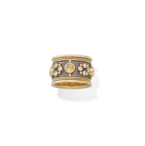 A yellow sapphire and diamond ring, by Elizabeth Gage,