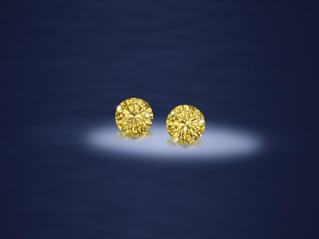 A pair of fancy-coloured diamond and diamond earclips