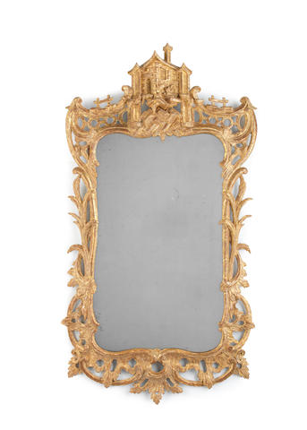 A carved giltwood mirror in the George II/III style