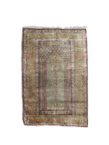 A Turkish silk prayer rug 93cm x 137cm