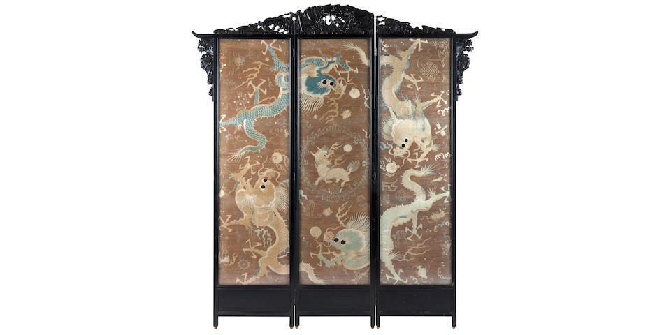 An ebonised three-fold dressing screen of large proportions Meiji era