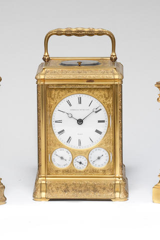 A fine 19th late century French grande sonnerie striking engraved brass carriage clock with calendar dials Litherland Davies and Co