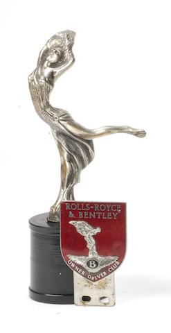 A rare 'Rolls-Royce & Bentley Owner Driver Club' badge and a 'Draped Nude' mascot,  ((2))
