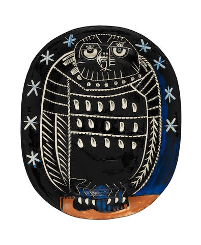 Pablo Picasso (Spanish, 1881-1973) Bright Owl Glazed ceramic dish painted in black, white and blue, 1955, from the edition of 450, with the Edition Picasso and Madoura Plein Feu stamps on the underside, in very good conditionWidth 390mm., Length 320mm.