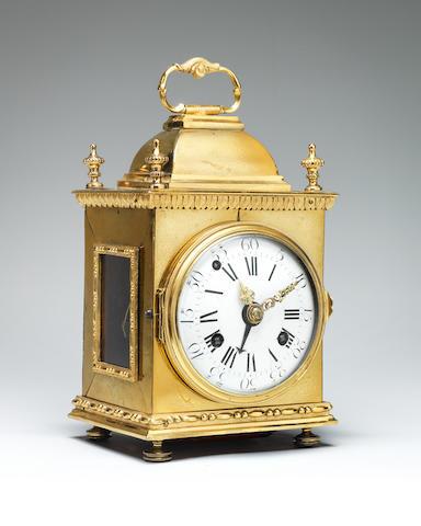 A late 18th century continental quarter striking ormolu mantel clock of small size